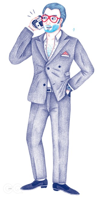 Double-breasted suit with the peakiest lapels possibleAccessories include Tom Ford sunglasses, Patek Philippe watch, David Beckham stubbleLooks like a human Mercedes convertible