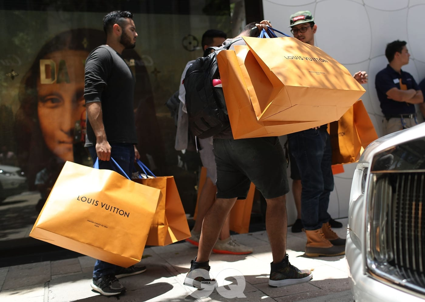 MIAMI, FL - JUNE 30:  Shoppers carry their Louis Vuitton bags from the store where they were selling limited edition supreme and Louis Vuitton collaboration items on June 30, 2017 in Miami, Florida.  The Louis Vuitton X Supreme collection pre-launched today in the American markets of Miami and Los Angeles with other pop-up locations worldwide that included Sydney, Tokyo, Seoul, Beijing, Paris and London.  (Photo by Joe Raedle/Getty Images)